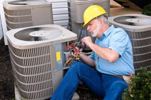 technician working on ac unit