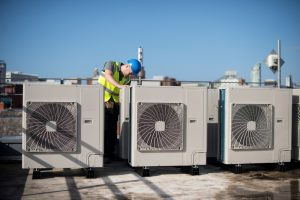 technician working on commercial AC units