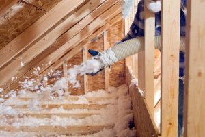 technician-installing-blown-in-insulation