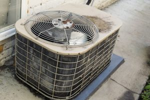 old-outdoor-air-conditioning-unit-showing-major-signs-of-wear